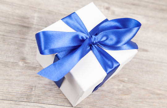 gift box on a grey wooden table